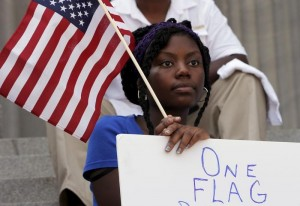 Asha Jones listens to the speakers during a rally outside the State House to get the Confederate flag removed from the grounds in Columbia, South Carolina June 23, 2015. REUTERS/Brian Snyder - RTX1HRVL