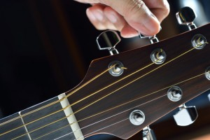 Tuning a guitar, Photo by amenic181, courtesy of Shutterstock http://www.shutterstock.com/gallery-816937p1.html