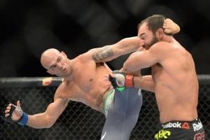 Robbie Lawler, Johnny Hendricks, MMA, UFC, fighting, pain, punch, kick