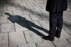 shadow, looming, oversee, oversight, regulators, shutterstock_183859805