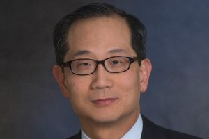 Carlyle Group, Kewsong Lee, private equity, healthcare, merger, M&A, China, trade