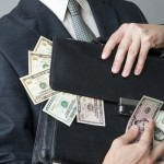 Businessman with briefcase full of money