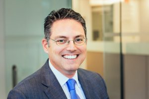 Justin Brass, Burford Capital, private equity, merger, M&A