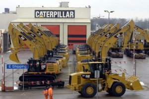 Caterpillar shares tank after fed raid