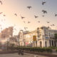 """Connaught Place, New Delhi, India during the early morning. Typical Georgian buildings are seen in the front. These are the commercial areas. The famous """"Statesman Building"""" is seen in the background. Shot taken from the inner Circle or Rajiv Chowk."""