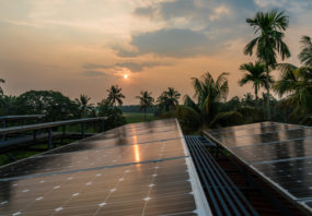 Sunset on solar panels in a village