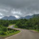 Man standing at the edge of road to Bhandardara