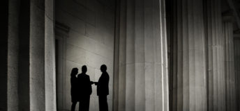 three people silhouetted against backdrop of power