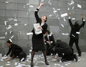 business people catching fallen money