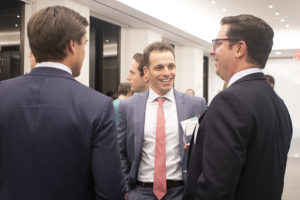 Strategic Partners' Brendan King in conversation with Weil's Brian Parness and Jonathon Soler, with BlackRock's Jarid Colucci in the background