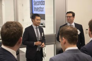 PEI's Adam Le welcomes attendees with Weil's Jonathon Soler