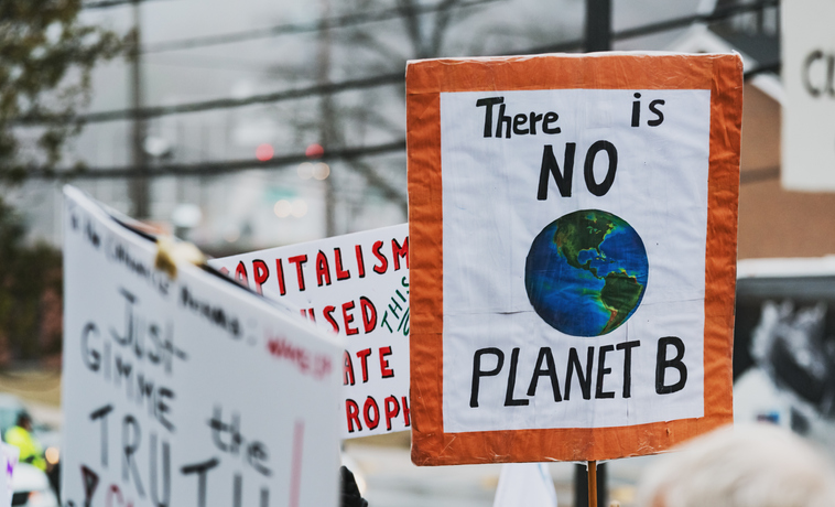 Climate change protestors hold their placards high.