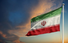 Iran flag at dusk