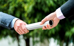 Business people passing baton