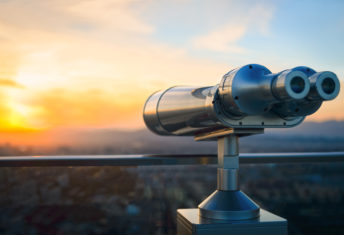 Binoculars or telescope on top of skyscraper at observation deck to admire the city skyline at sunset.Telescope located on the Beijing Olympic Tower