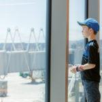 Boy looking through a window