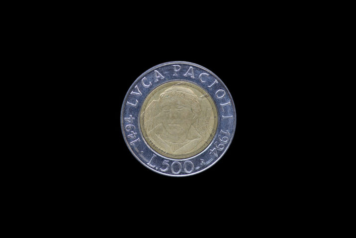 Italian lira coin bearing the portrait of Luca Pacioli (1447-1517), released by Italy in 1994 on the 500th anniversary of his treatise Summa de arithmetica (i.e. On arithmetics)