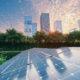 Solar Power Plant in modern city in sunset