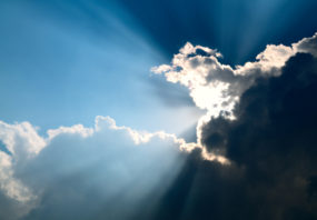 Sunbeam through the black stormy cloud, silver lining