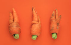 Imperfect food, deformed carrot, misshaped produce