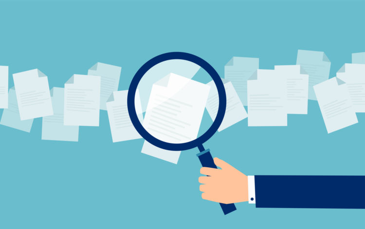 Employer with magnifying glass exploring application papers