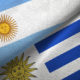 Uruguay and Argentina two flags together textile cloth, fabric texture
