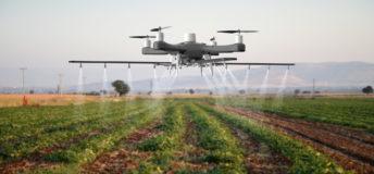 Drone spraying a field, agtech, crops