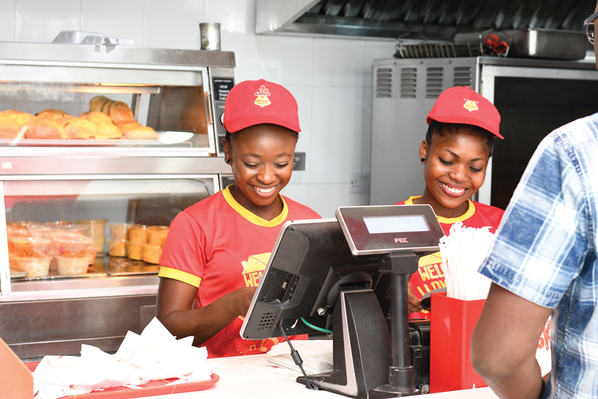 Staff working behind the counter of a fast food restaurant