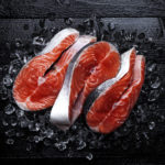 Salmon steaks on black background