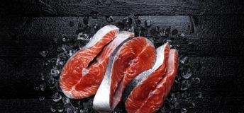 Salmon steaks on black background