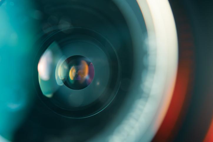 Camera lens in colorful light focus