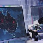 Futuristic laboratory. Virus spreading on Australia map. Scanning DNA mutations