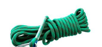 Climbing rope on white background.
