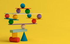 Several balancing geometric shapes, symbiosis, collaboration