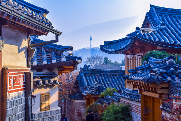 Korean houses with city in distance