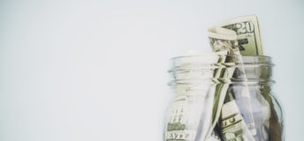 Donation jar overflowing with American money. Fundraising, Savings, Wealth Concepts.